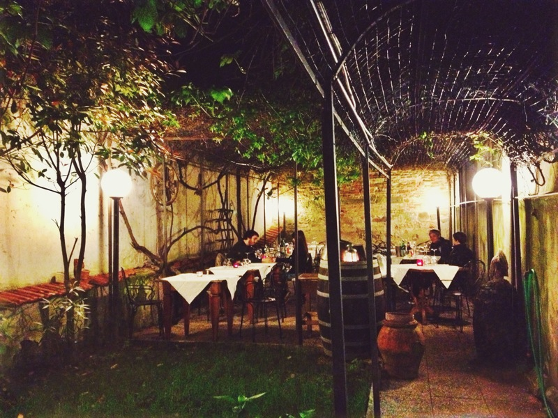 Dinner al fresco in a tucked-away garden in Florence